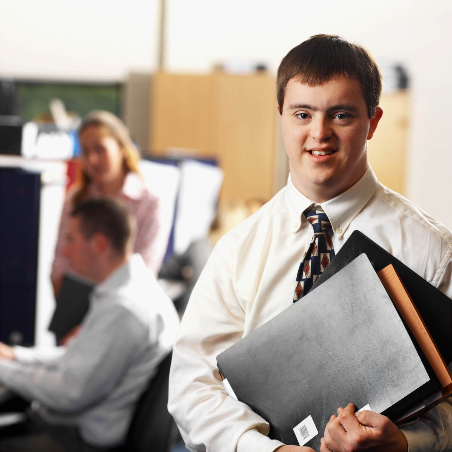 portrait of a man with down syndrome working in an office